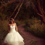 Bride walking in Nature Pathway
