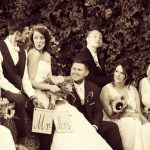Old Fashioned Wedding Photo with Friends on Hay Bale