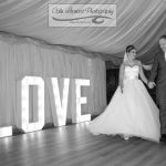 Couple by LOVE Letters inside Marquee