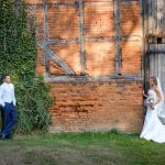 couple outside barn