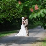 Newly Wed couple on tree covered path