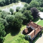 Drone view of Newland Hall marquee and river wedding venue essex
