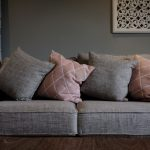 Grey and Pale Pink Sofa in Room