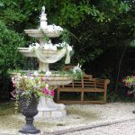 Decorated Fountain with Leaves and flower beds