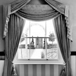 Window with curtains tied back looking out at marquee ceremonial area wedding venue essex