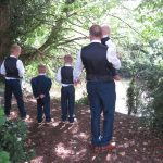 Groom and Sons overlooking river at wedding venue essex