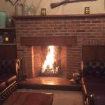 Fireplace in Armoury Room at Newland Hall wedding venue essex