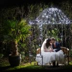 Metal Bench frame cover with fairy lights bride and groom wedding venue essex