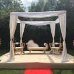 Seating area at end of red carpet wedding venue essex