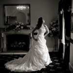 Bride standing at the window