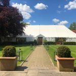 Large Marquee spanning garden area entrance at wedding venue essex