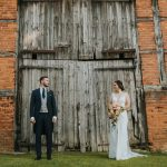 Bride and Groom outside of Barn Door
