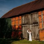 Bride and Groom outside of Barn Doors